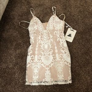 Tight white lacy dress from Peppermayo